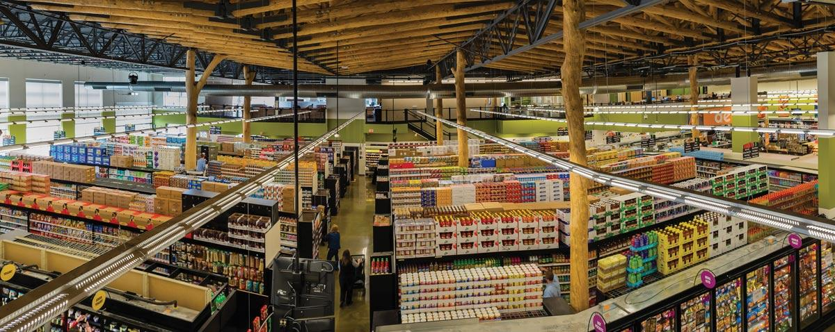 Figure 5. Festival Foods Grocery Store (Madison, WI). The red pine SRT trusses span up to 55 feet and support up to 500lbs/lf. The load-bearing Ash Columns support up to 220kip in live and dead loads. Courtesy of Heartland Photography.
